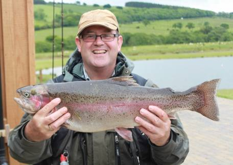 Ruben Pool who won the Blyth and Wansbeck Fly Fishers with this 7lb 15oz rainbow on a green flash back beetle