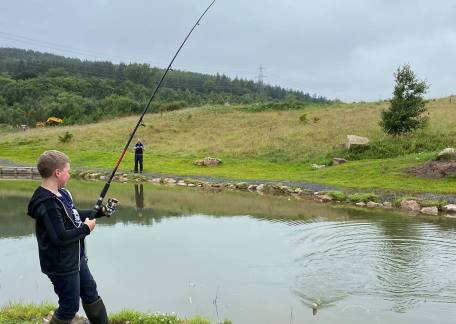Young Harry into his first fish on Cragend, our new bait lake