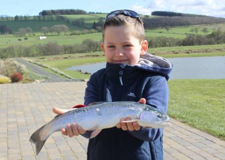 8 year old Sebastian Cemei from Dublin with his first fish on a fly landed on a yellow owl