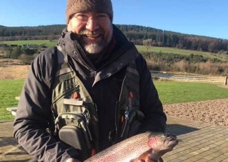 Pete Askew with his new PB Rainbow, weighing in at 4lb 4oz caught using a Mini Cat.