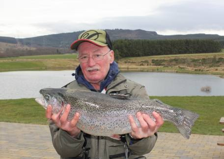 Alan Robinson from Swalwell holding his friend Alfie's 7lb 15oz rainbow which he landed on a cats whisker from Long Crag