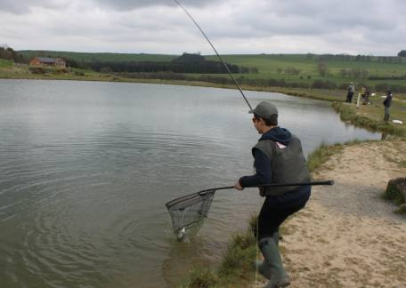 Thrunton Junior Shaun Silk netting his first fish