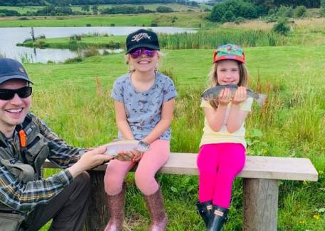 Izzy and Olivia with their first catches on Crag End Bait Lake