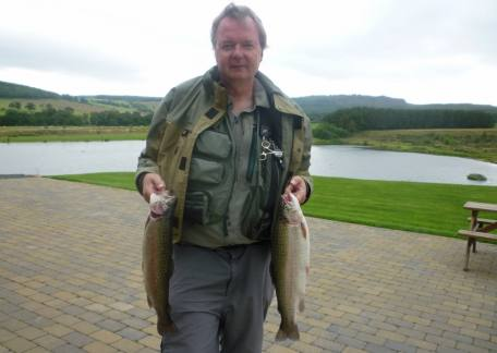 David Dodds from Ashington with two 4lb rainbows landed on a CDC Hopper