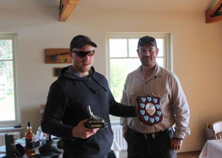 Ross Dixon receiving the Eddie Kilgour Memorial trophy from Anthony Meadows