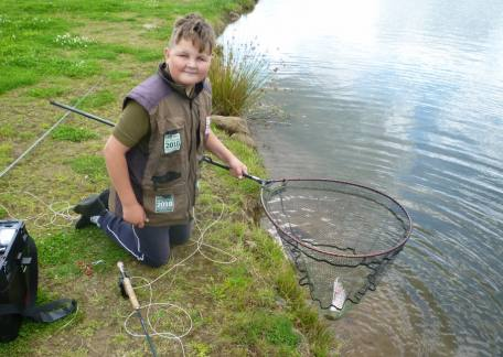 Thrunton Junior and regular Jack Metcalf with another fish to the net. Well done Jack