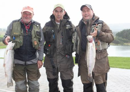 Livingston anglers John Middleton, J, Ryce and David Frater with two of their many fish landed through the day