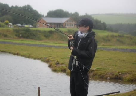 9 year old George Clark from Ellerdine catching a fish in the Uk junior Troutmasters Final