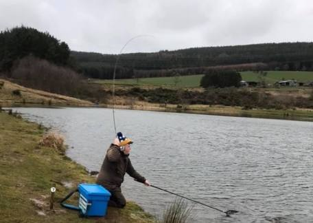 Brad Mackie netting a fish from Long Crag