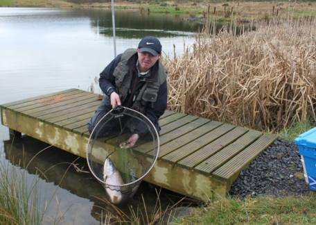 Andy Richmond from Dreghorn who netted and safely returned a 14lb brown on a neon hackle minkie