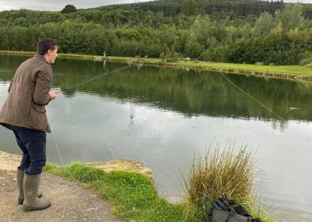Ed Forster playing his first ever fish on a fly rod, while having a lesson with Level 2 Game angling coach Joe Dewhirst