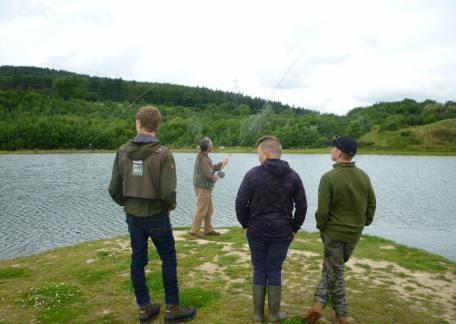 Another group of Thrunton Juniors watching a demonstration of double handed casting with Barry Mitchell ( www.barrymitchellflyfishing.com)