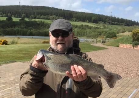 Peter Wilkinson with a nice Rainbow he caught on a Damsel