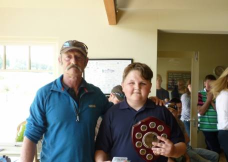 Jack Metalf with Peter McEwan after winning the James Robinson shield for the biggest fish landed by a Junior