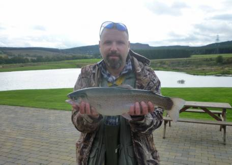 Cameron Graham from Morpeth used a bloodworm to tempt this 4lb 2oz rainbow from Coe Crag