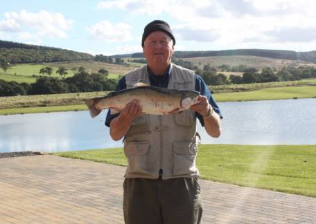 Arthur Leach from Washington enjoyed his day landing this 8lb rainbow, his personal best, on a black hopper