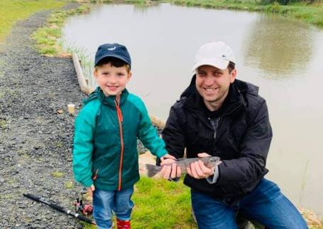 Chris Dodd enjoying some quality time with his son, catching their first fish together