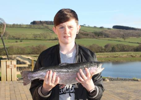 David Woods from Newcastle with a 4lb 5oz rainbow caught on a Farmoor holo