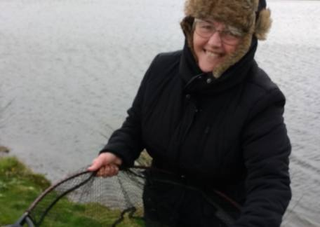 Katherine McEwan from Alnwick was delighted with her first ever fish, a 12lb rainbow on a red & silver fry pattern