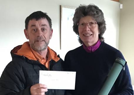 Lee presenting Hillary with a new Greys rod and fishing voucher.