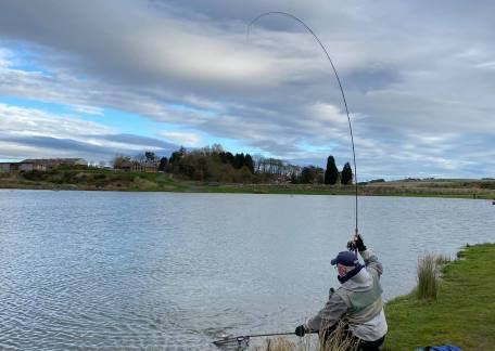 Kevin Dinning just about to net a 3lb Rainbow