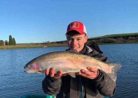 16 year old, Harrison Douds with one of the larger rainbow's landed from the boat.