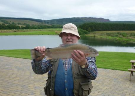 Peter Wilkinson from The Eyewater Club with the heaviest fish, a 5lb 12oz rainbow from Long Crag