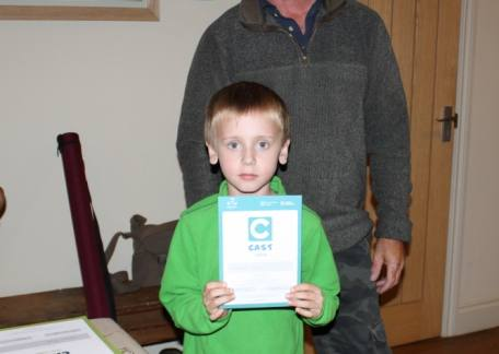 Young Edward Graham with his Angling Trust CAST Award