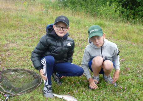 Two of the pupils from Ashbrooke School were delighted to land and net a fish