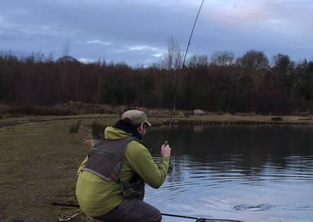 Guy Nicholson in action landing an estimated 10 - 12lb rainbow from Coe Crag on a Chris Evans