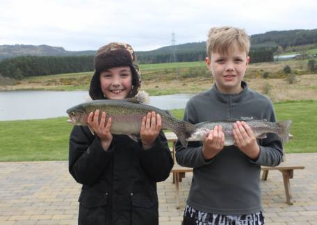 9 year old William Wood with his first ever trout, a 4lb 2oz rainbow attempted on a size 16 PTN