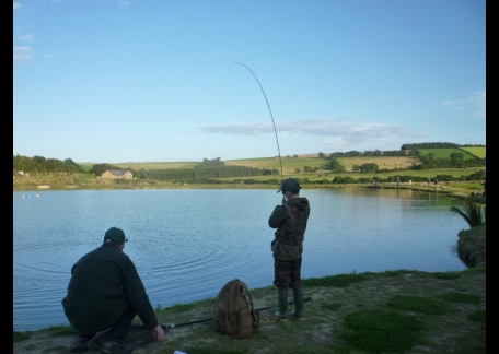 Jono showing his Dad how to catch a fish
