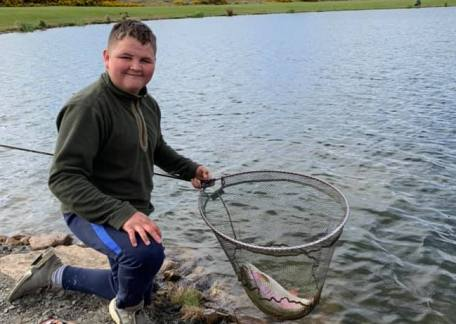 Thrunton Youth angler, Jack Metcalf safely released this cracking Rainbow to Long Crag