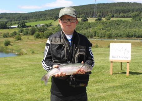 Adam Straughan from Stakeford with one of his fish he netted during a session with the Trout Ticlkers