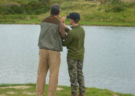 Andrew receiving some guidance on using a double handed rod