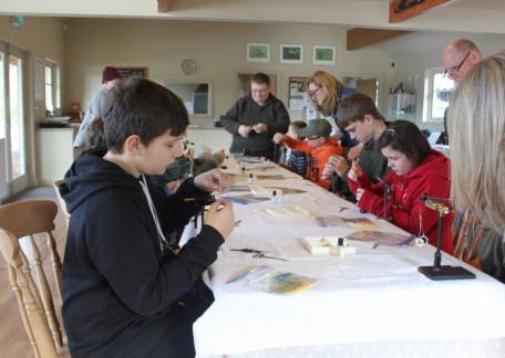 Thrunton Juniors enjoying another fly tying session with Paul Griffin